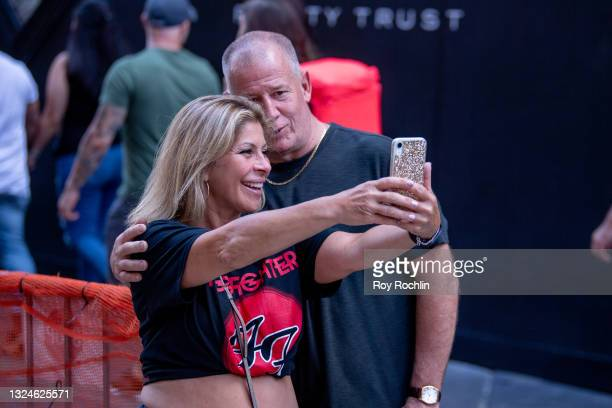 Couple take a selfie wearing a Foo Fighters shirt as Madison Square Garden reopens with the first full capacity concert since March 2020 on June 20,...