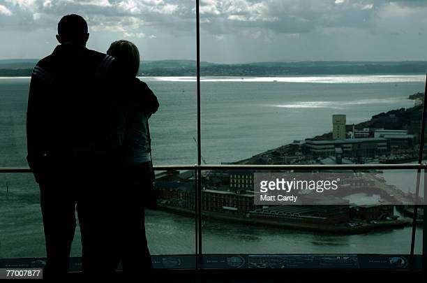 A couple take in the view from inside the Spinnaker Tower on September 25 2007 in Portsmouth England Originally scheduled for completion in time for...