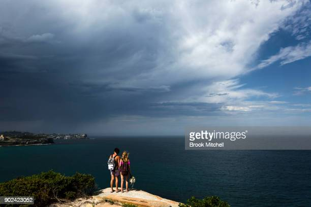 A couple take in the view over Bronte as an afternoon thunderstorm rolls over Sydney on January 8 2018 in Sydney Australia Sydney was the hottest...