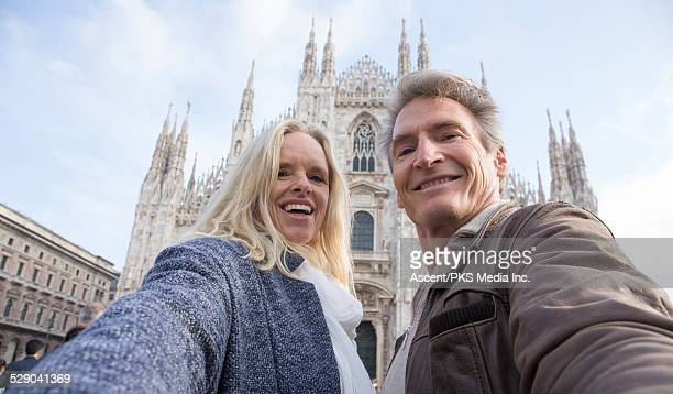 Couple take selfie pic with Duomo behind