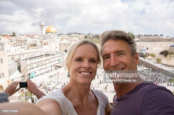Couple take selfie portrait above Western Wall