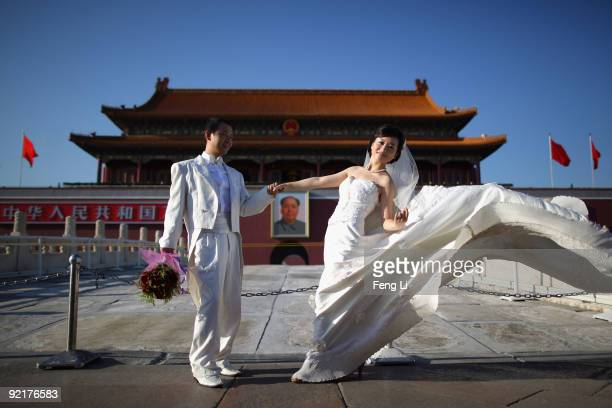 A couple take wedding pictures in front of the Tiananmen Gate on September 8 2009 in Beijing China Many people are expected to hold their wedding on...