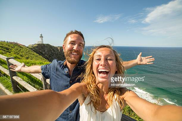 Couple takes a selfie by the sea