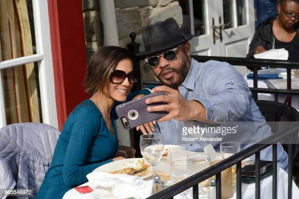 A couple takes a 'selfie' photograph after eating at a restaurant in the Old Town section of Alexandria Virginia