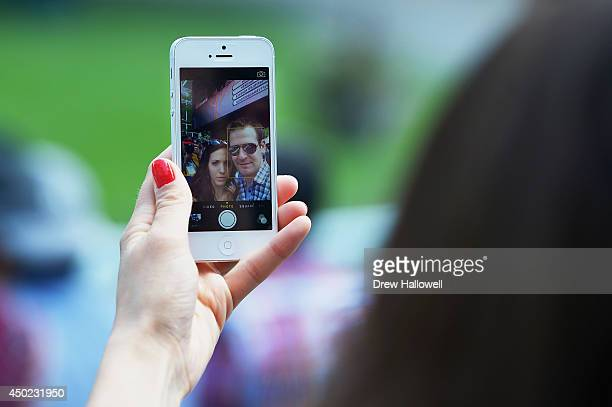 A couple takes a selfie prior to the Belmont Stakes at Belmont Park on June 7 2014 in Elmont New York