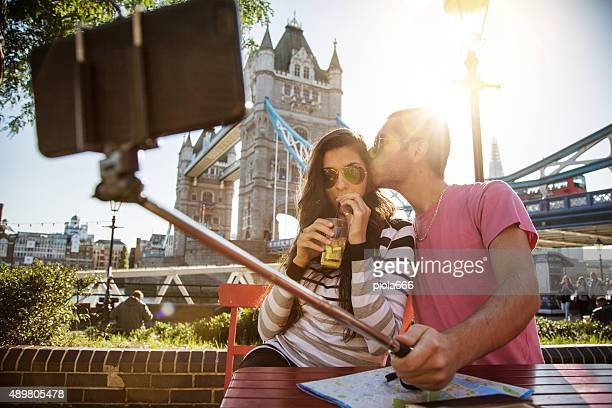 Couple takes a selfie stick in front of Tower Bridge