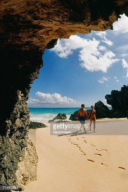 A couple takes a stroll on Horseshoe beach, Bermuda
