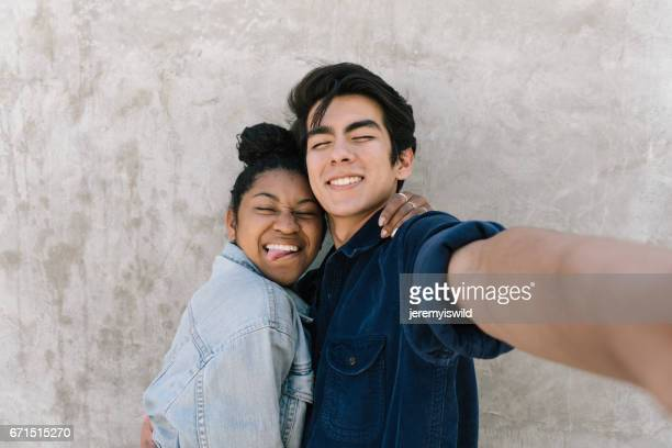 couple takes fun selfie! - teenage couple stock photos and pictures