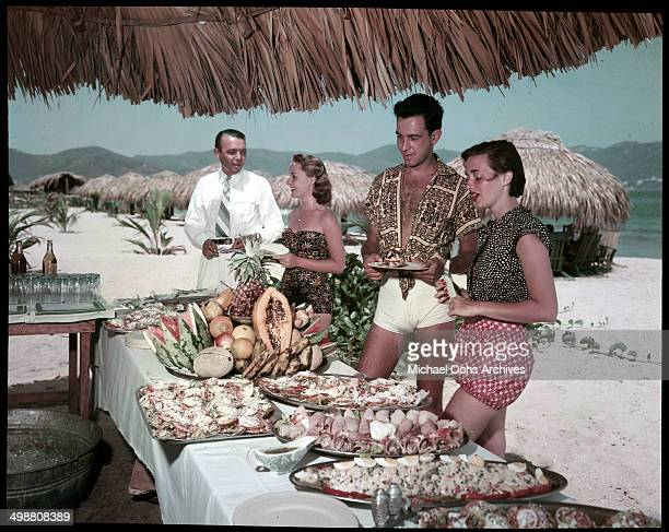 A couple takes in a clam back at the beach in Acapulco Mexico in July 1953