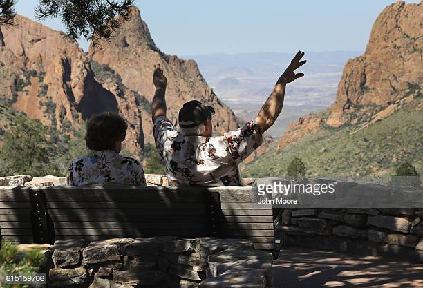 Couple takes in the view at the Chisos Basin in Big Bend National Park on October 16, 2016 in West Texas. Big Bend is a rugged, vast and remote...