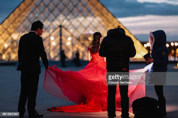 Couple takes wedding pictures at the Louvre in front of the Pyramid on November 06 2016 in Paris France All over the year couples come to take...