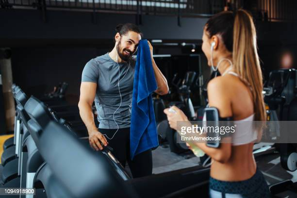 couple taking a break after workout at gym - leisure facilities stock pictures, royalty-free photos & images