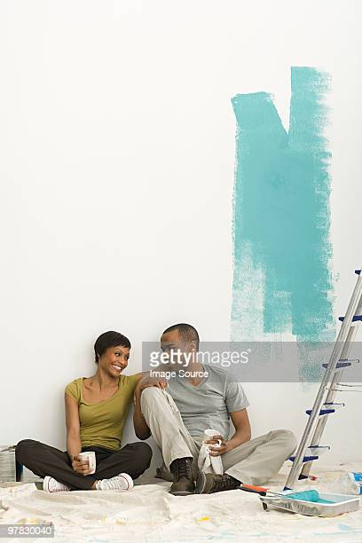 Couple taking a break from painting