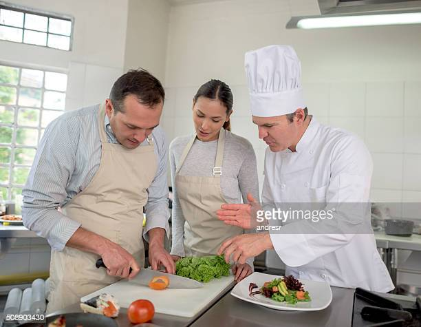 Couple taking a cooking class