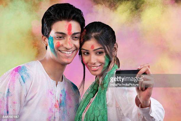 couple taking a photograph of themselves - new generation stock pictures, royalty-free photos & images