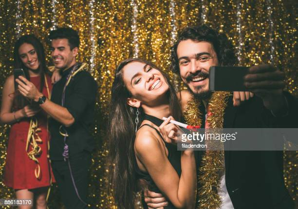 Couple taking a selfie at a party
