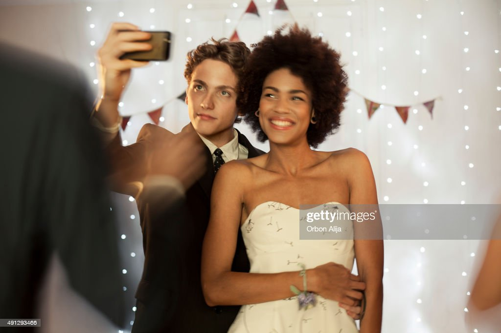 Couple taking a selfie at prom party : Stock Photo