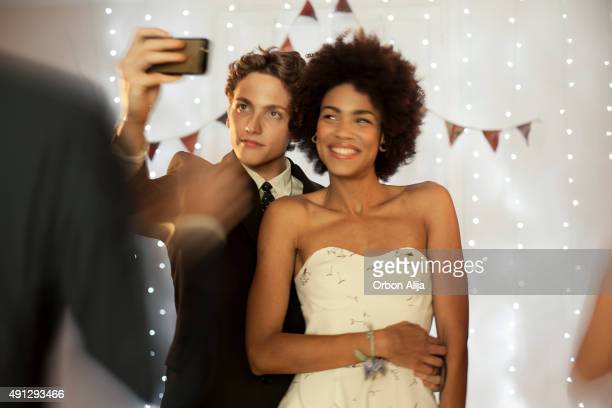 couple taking a selfie at prom party - prom stock pictures, royalty-free photos & images
