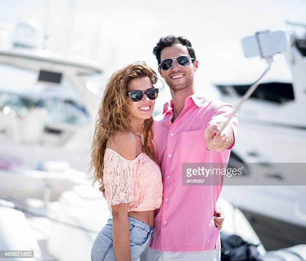 Couple taking a selfie next to a boat