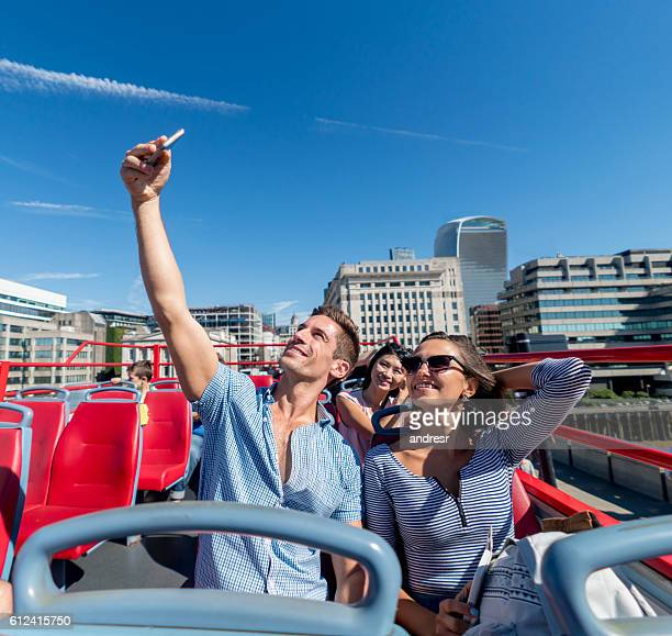 Couple taking a selfie on a tour bus