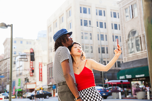 A couple taking a selfie - gettyimageskorea