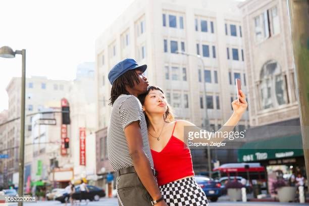 a couple taking a selfie - facebook friends stock pictures, royalty-free photos & images