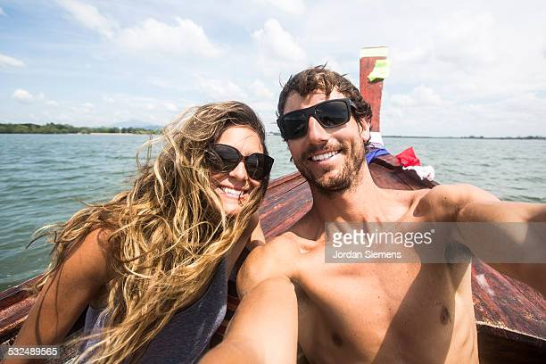 A couple taking a selfie.