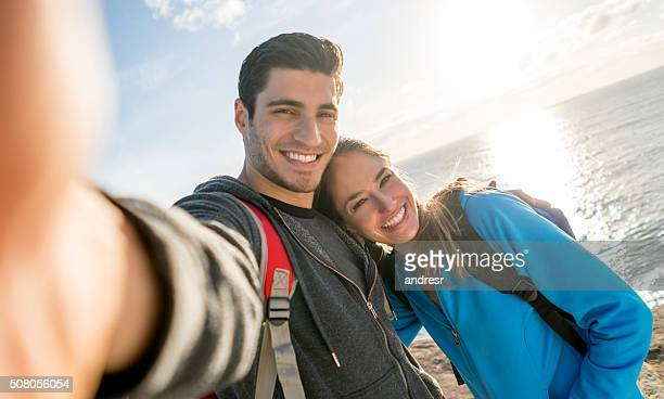 Couple taking a selfie while hiking