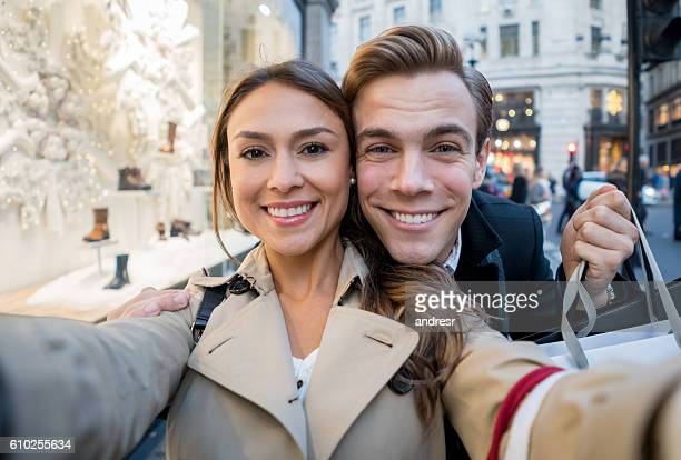 Couple taking a selfie while shopping