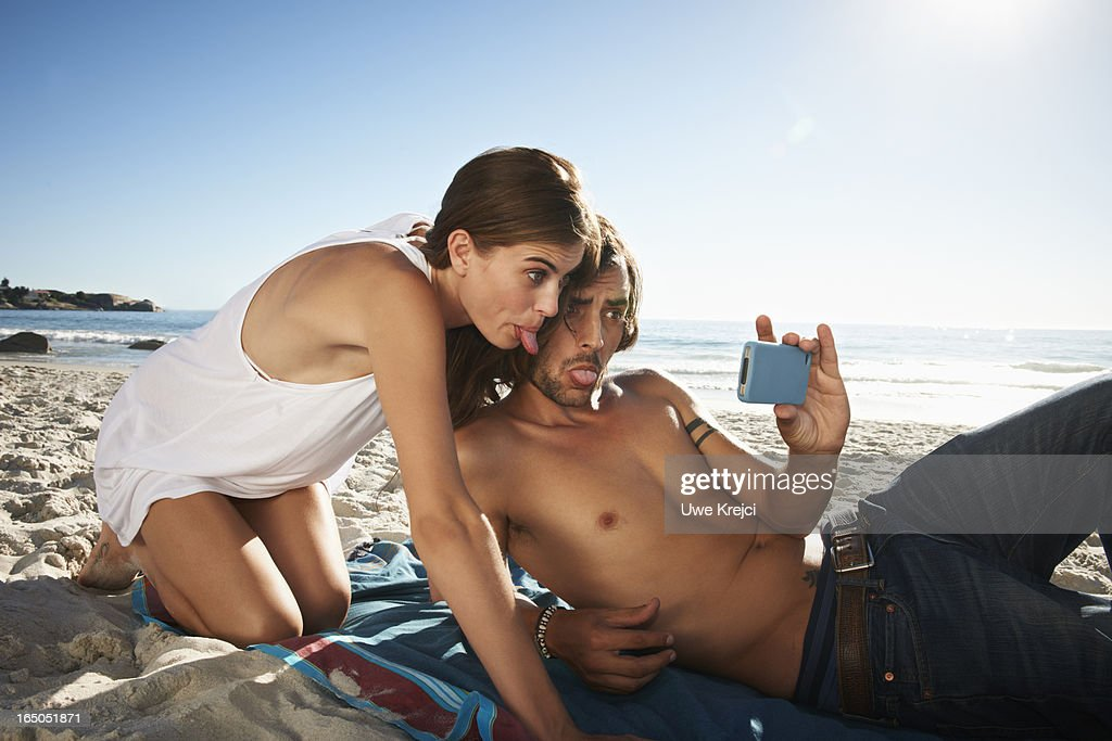 Couple taking a self-portrait with smart phone : Stock Photo
