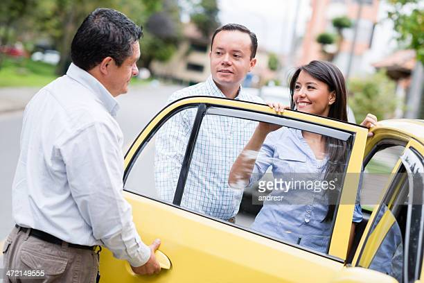 couple taking a taxi - taxi driver stock photos and pictures