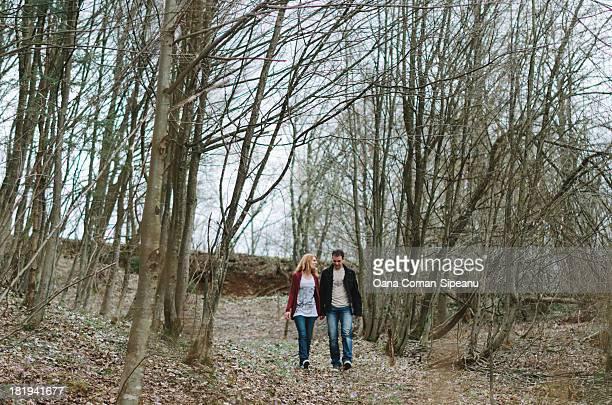 Couple taking a walk through a grove