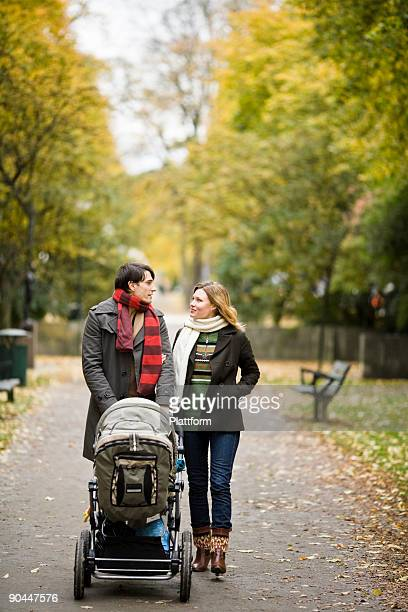 a couple taking a walk with their son sweden. - carriage stock pictures, royalty-free photos & images