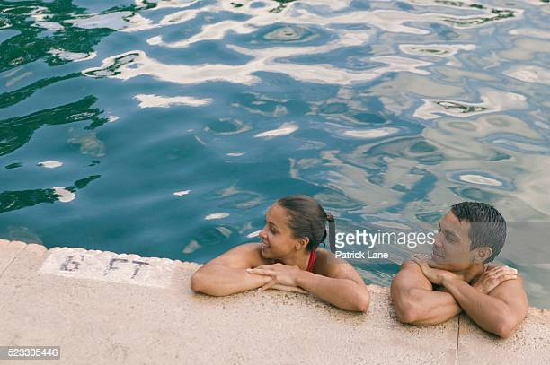 Couple Taking Break from Swimming