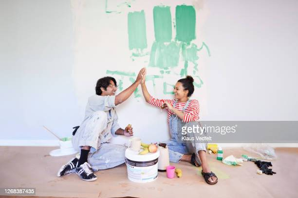 couple taking break while renovating home - home improvement stock pictures, royalty-free photos & images