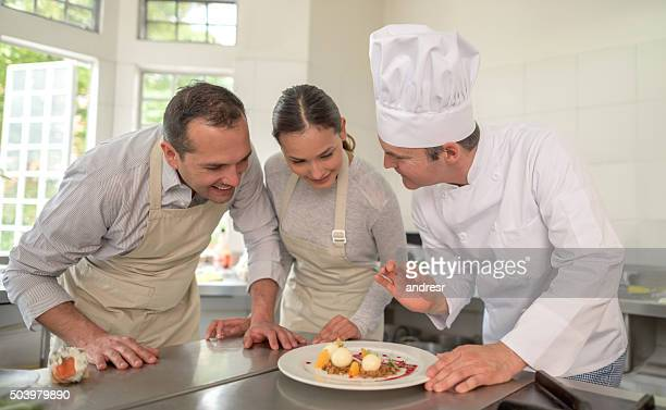 Couple taking cooking lessons