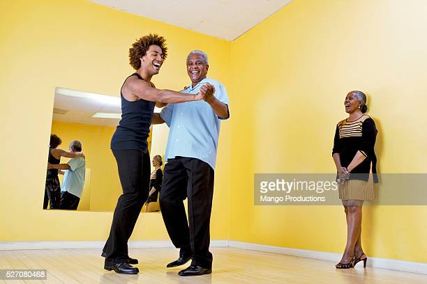 Couple taking dance lessons