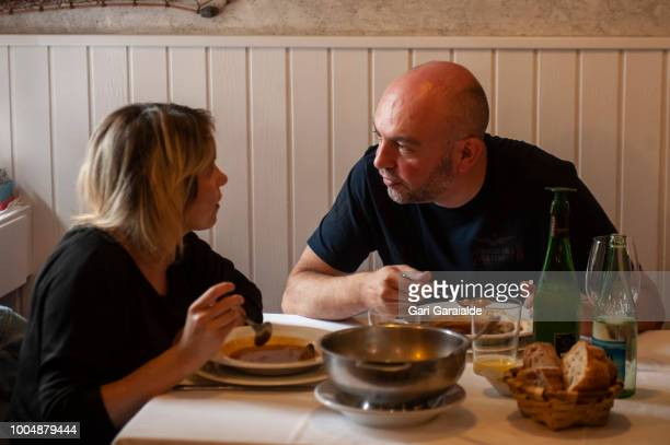 A couple taking fish soup at the Restaurante Hermandad de Pescadores on July 20 2018 in Hondarribia Spain The restaurant became famous when in 2011...
