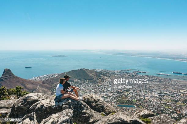 couple taking in view on table mountain, cape town - table mountain stock pictures, royalty-free photos & images