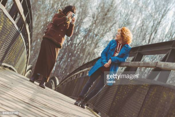 couple taking photos between them - between stock pictures, royalty-free photos & images