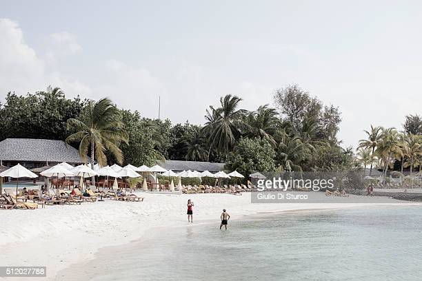 A couple taking photos on the beach in the afternoon during their honeymoon on February 01 2016 at Centara Ras fushi Resort and Spa Maldives China's...
