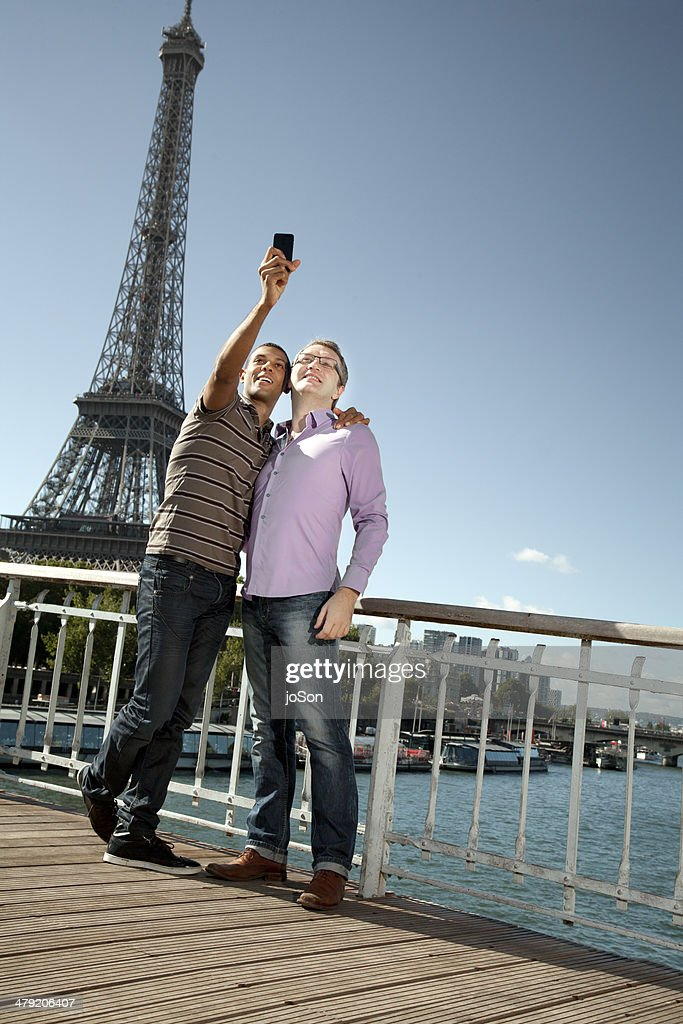 Couple taking picture with mobile phone, Paris : Stock Photo