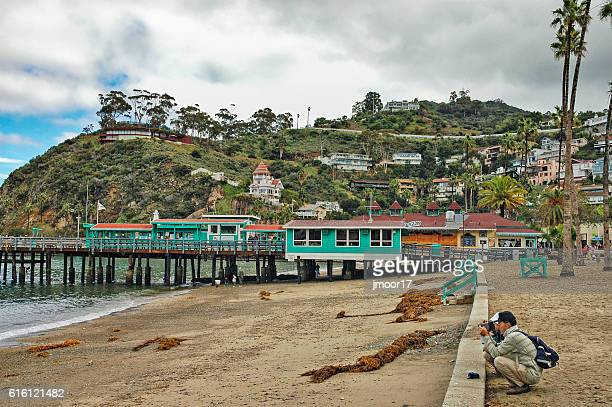 Couple Taking pictures on Santa Catalina Island homes on hill