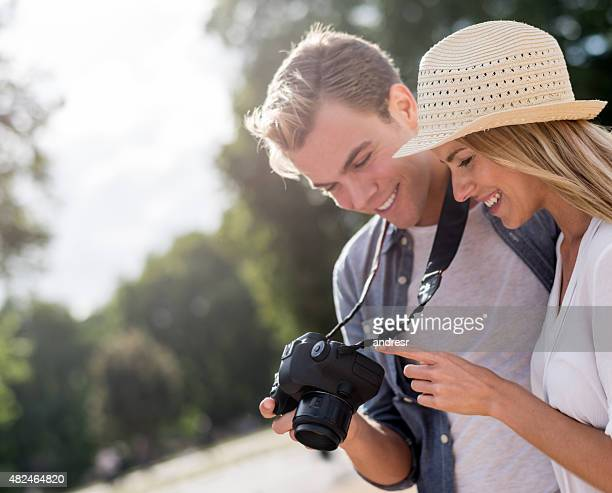 Couple taking pictures outdoors