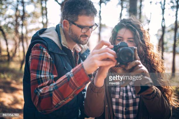 couple taking pictures outdoors - photography themes stock pictures, royalty-free photos & images