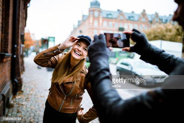 couple taking pictures - photographing stock pictures, royalty-free photos & images