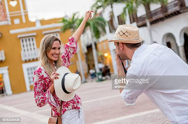 Couple taking pictures while traveling