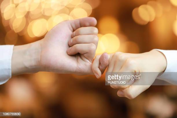 Couple taking pinky promise