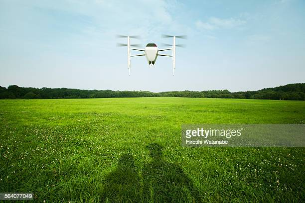 Couple taking selfie by drone in park