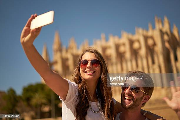 couple taking selfie in front of cathedral - majorca stock pictures, royalty-free photos & images
